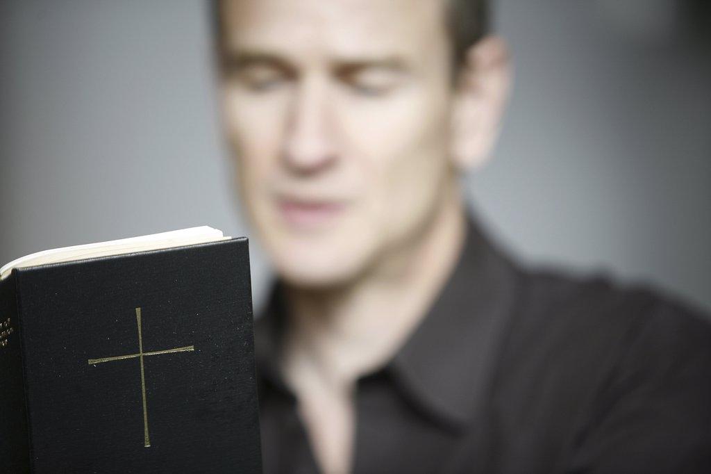 France, Paris, Man reading the Bible : Stock Photo