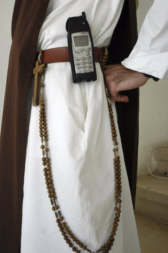 Stock Photo: 1606-73787 Israel, Emmaüs-Nicopolis, Catholic monk with mobile phone in Emmaus Nicopolis