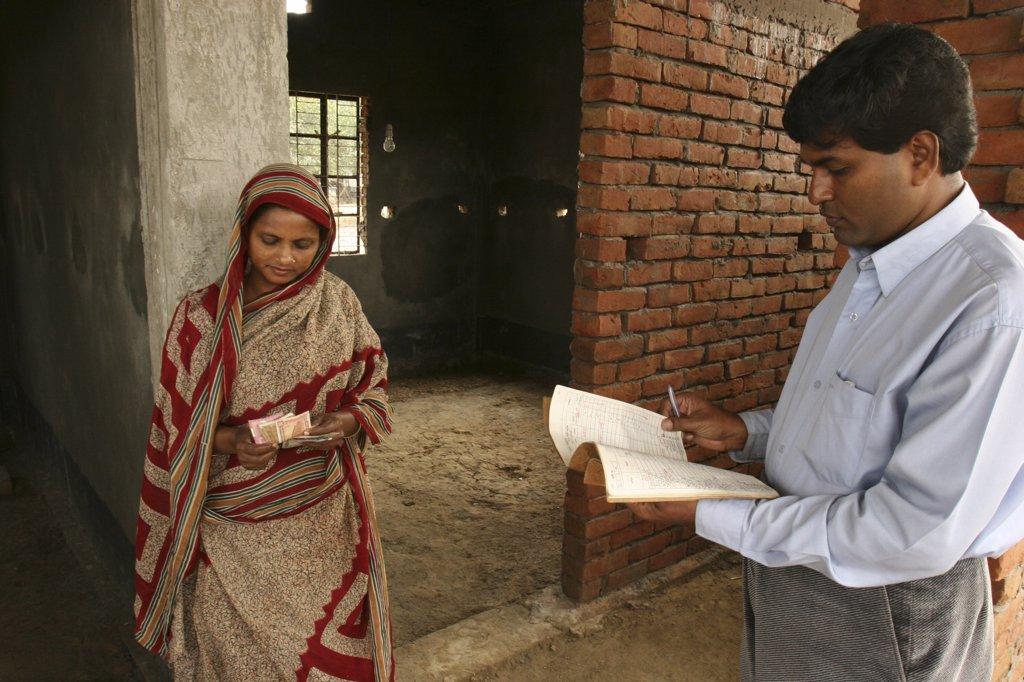 Bangladesh, Gazipur, Bariali, Woman receiving a Grameen Bank housing loan : Stock Photo