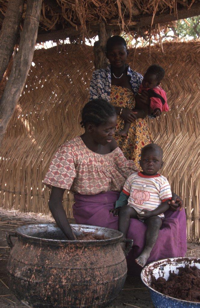 Stock Photo: 1606-78029 Burkina Faso, Ouagadougou, Mother fixing meal