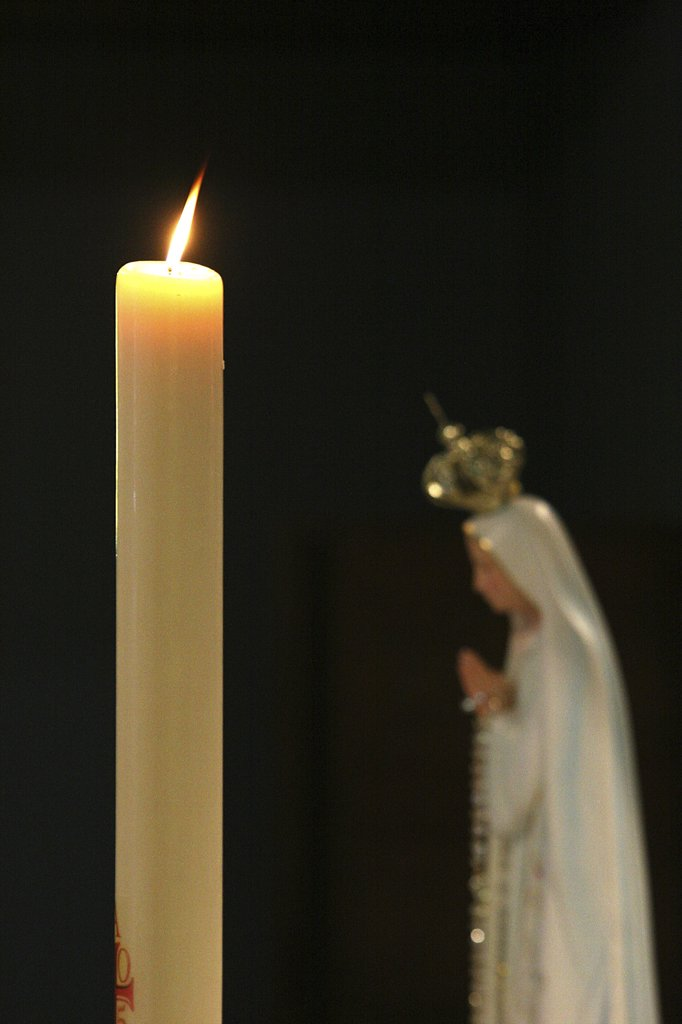 Stock Photo: 1606-79040 France, Le Fayet, Candle and virgin