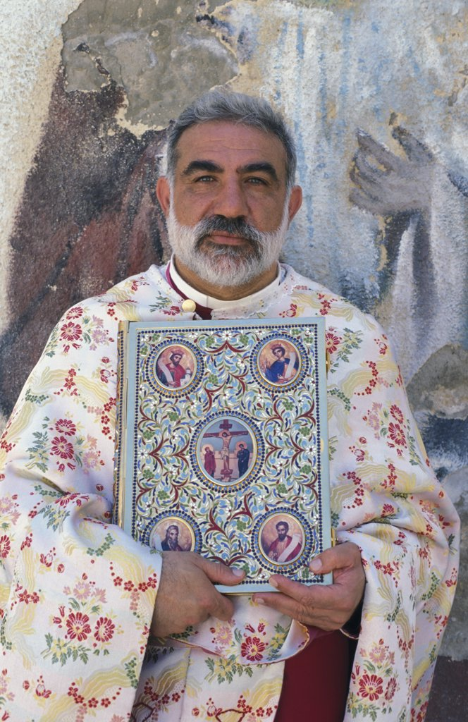 Israel, Galilée, Nazareth, Melkite priest Emile Shoufani holding the new testament : Stock Photo