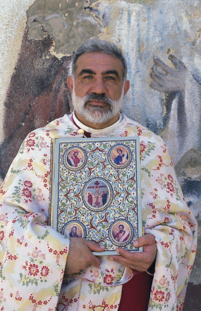 Stock Photo: 1606-79388 Israel, Galilée, Nazareth, Melkite priest Emile Shoufani holding the new testament