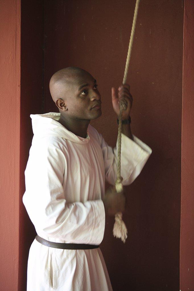 Sénégal, Keur Moussa, Monk caling to prayer at Keur Moussa abbey : Stock Photo