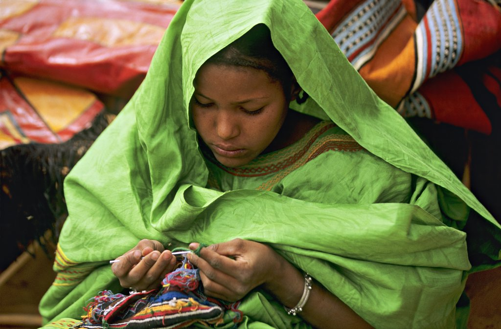 Stock Photo: 1606-83029 Mali, portrait of a  touareg young woman embroidering