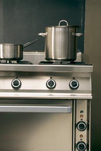 Stock Photo: 1606-83105 Saucepan and stewpot in stainless steel on gas cooker, buttons