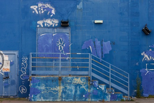 France, blue facade with tags : Stock Photo