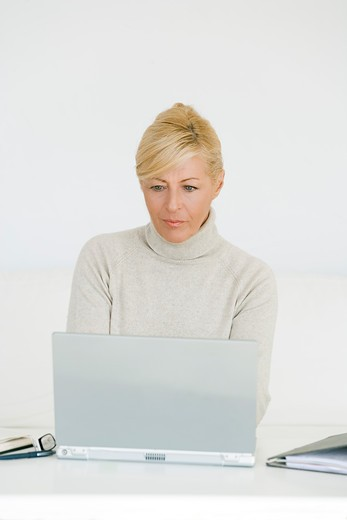 Stock Photo: 1606-92065 Mature woman using laptop