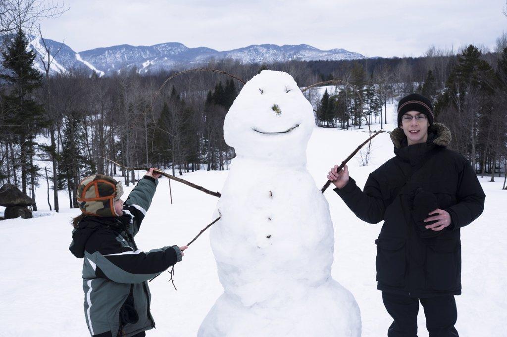 Children with snowman : Stock Photo