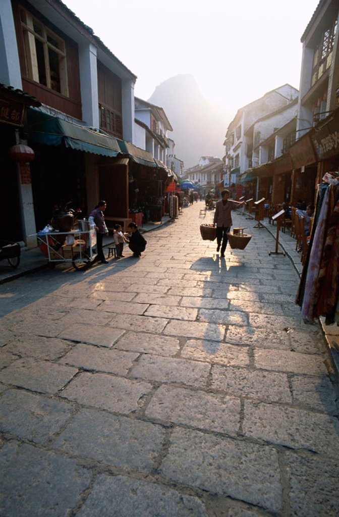 Stock Photo: 1609-12201 Streeet Scene / Cobblestone Street, Guilin / Yangshou, Guangxi Province, China