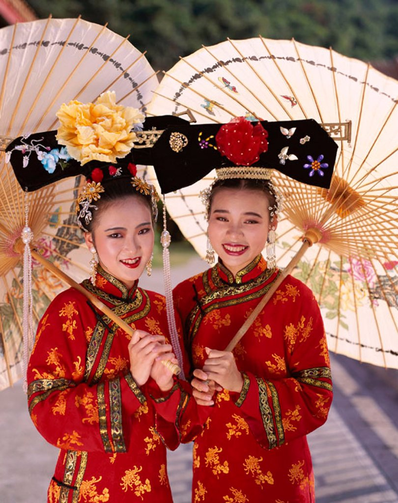 Stock Photo: 1609-12294 Women Dressed in Traditional Costume, Beijing, China. Women Dressed in Traditional Costume        , Beijing  , China