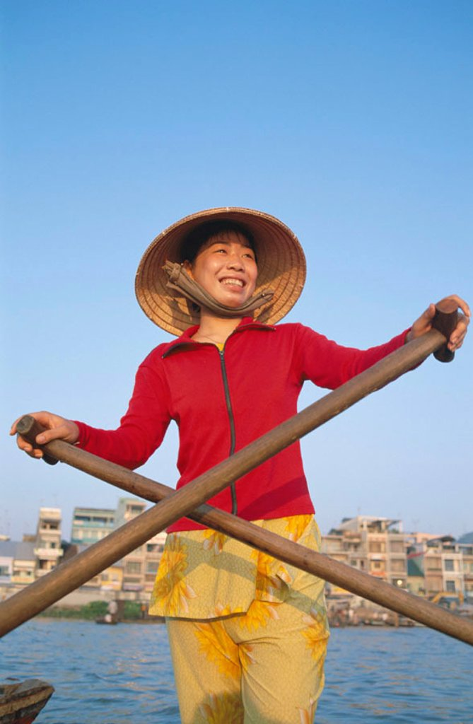 Stock Photo: 1609-12449 Boat Woman on Mekong River, Cantho, Mekong Delta, Vietnam
