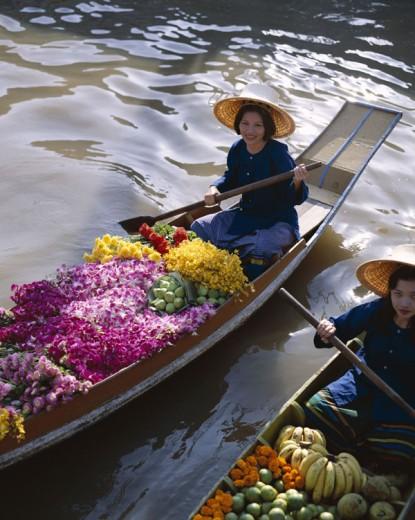 Damnoen Saduak / Floating Market / Female Vendors Selling Fruit and Flowers, Bangkok, Thailand : Stock Photo