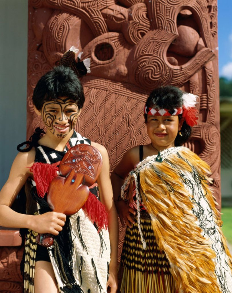 Stock Photo: 1609-13889 Maori Children / Young Girl and Boy Dressed in Maori Dress / Traditional Costume, Rotorua, North Island, New Zealand