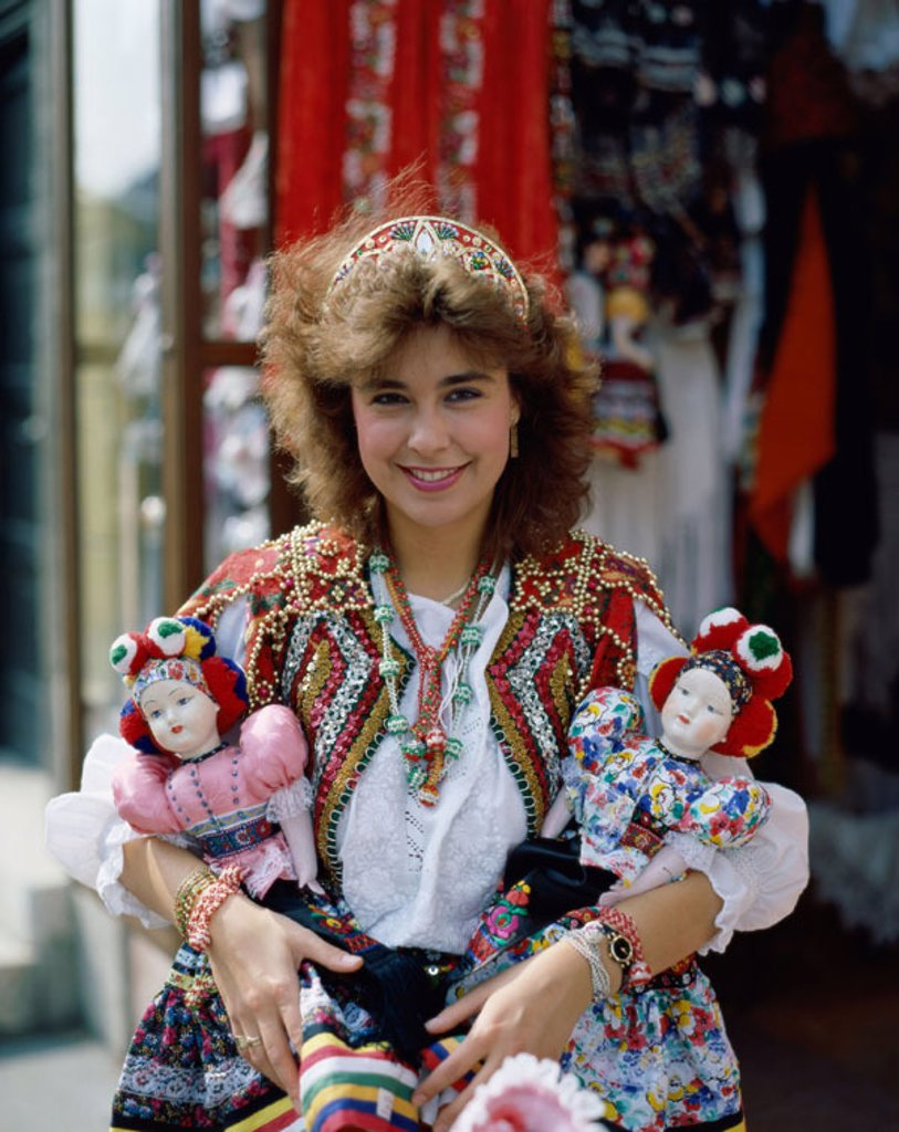 Stock Photo: 1609-14152 Buda / Fishermen´s Bastion, Budapest, Hungary. Girl Dressed in Traditional Hungarian Costume Selling Souvenir Dolls, Budapest, Hungary