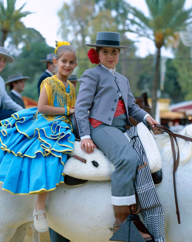 Fiesta / Horse Fair / Girls Dressed in Andalucian Costume, Jerez de la Frontera, Andalusia, Spain : Stock Photo