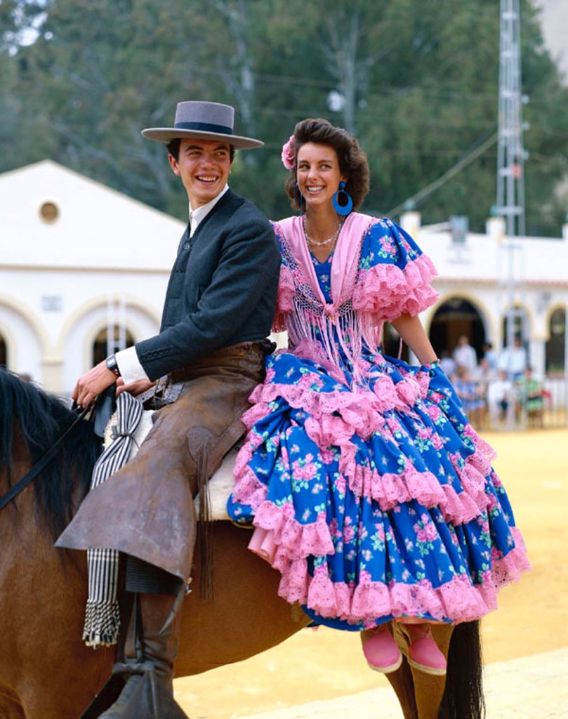 Stock Photo: 1609-15092 Fiesta / Horse Fair / Couple Dressed in Andalucian Costume, Jerez de la Frontera, Andalusia, Spain