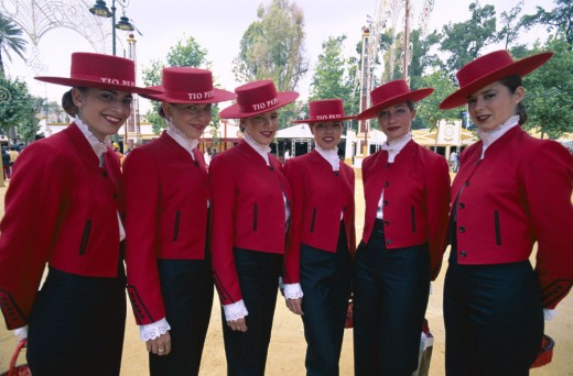 Fiesta / Horse Fair / Girls Dressed in Tio Pepe Company Logo Costume, Jerez de la Frontera, Andalusia, Spain : Stock Photo