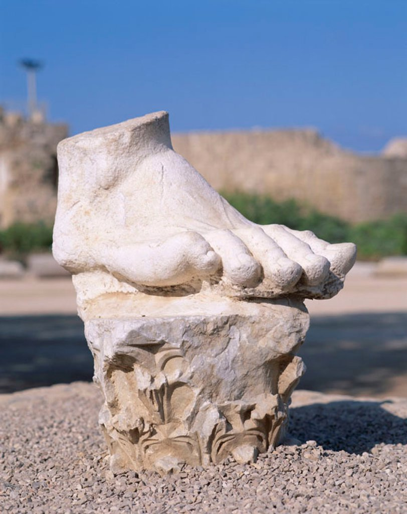 Stock Photo: 1609-15614 Crusader City Ruins / Statue of Foot, Caesarea, The Coast, Israel
