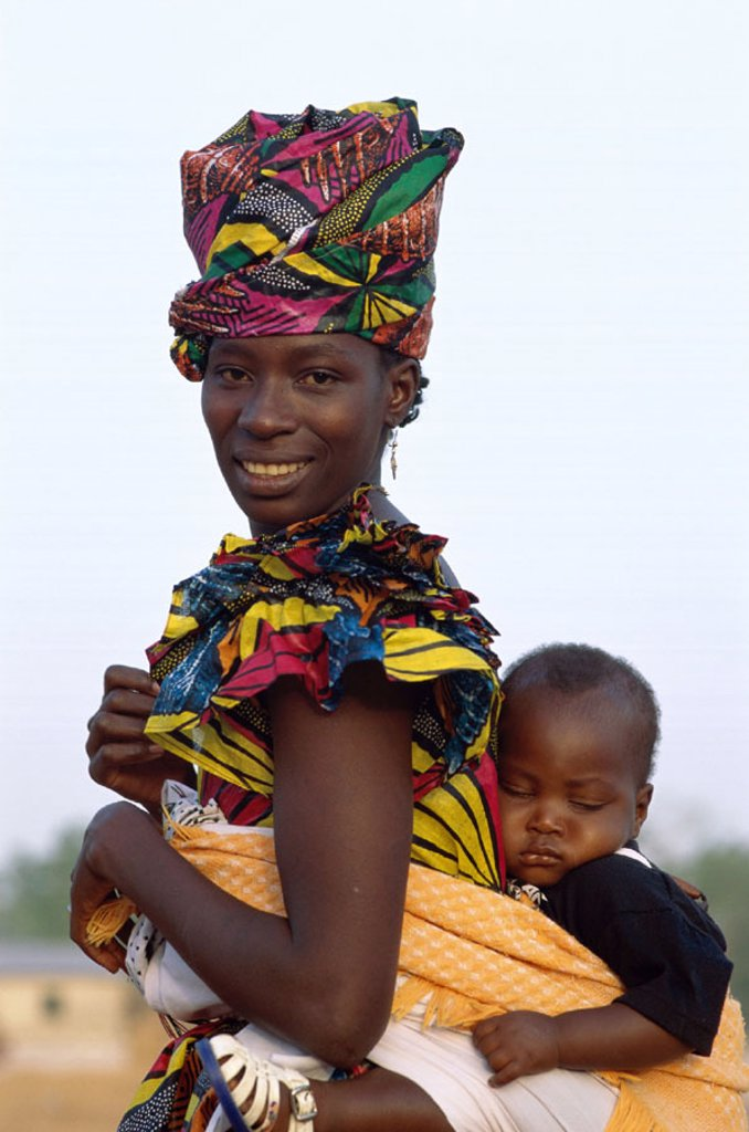 Stock Photo: 1609-15831 African Woman Carrying Baby on Back, Banjul, Gambia