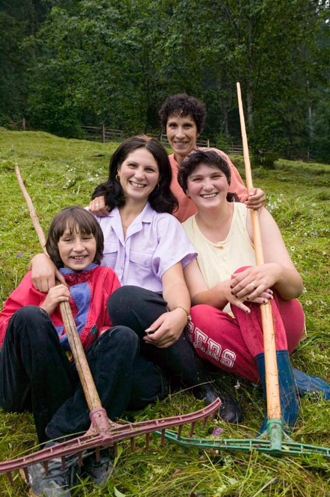 Women with rakes, Bucovina, Romania : Stock Photo
