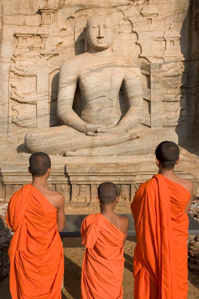 Stock Photo: 1609-19121 Monks praying to the Buddha, Gal Vihara, Polonnaruwa, Sri Lanka