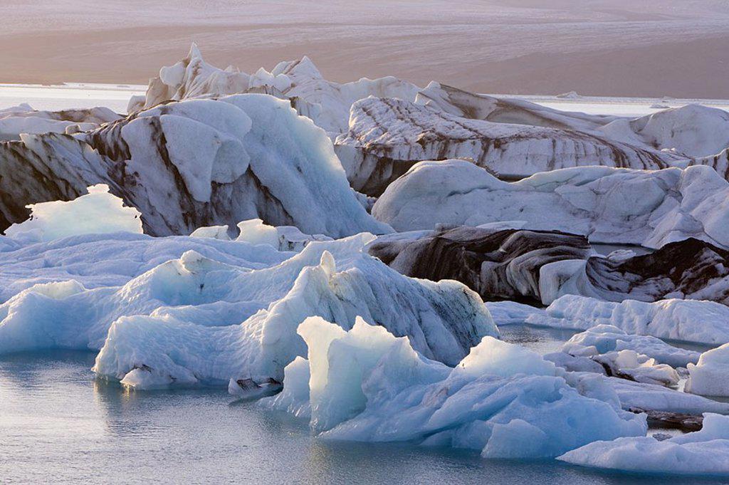 Icebergs floating in the Lagoon beneath Breidamerkurjokull Glacier, Jokulsarlon, Iceland : Stock Photo