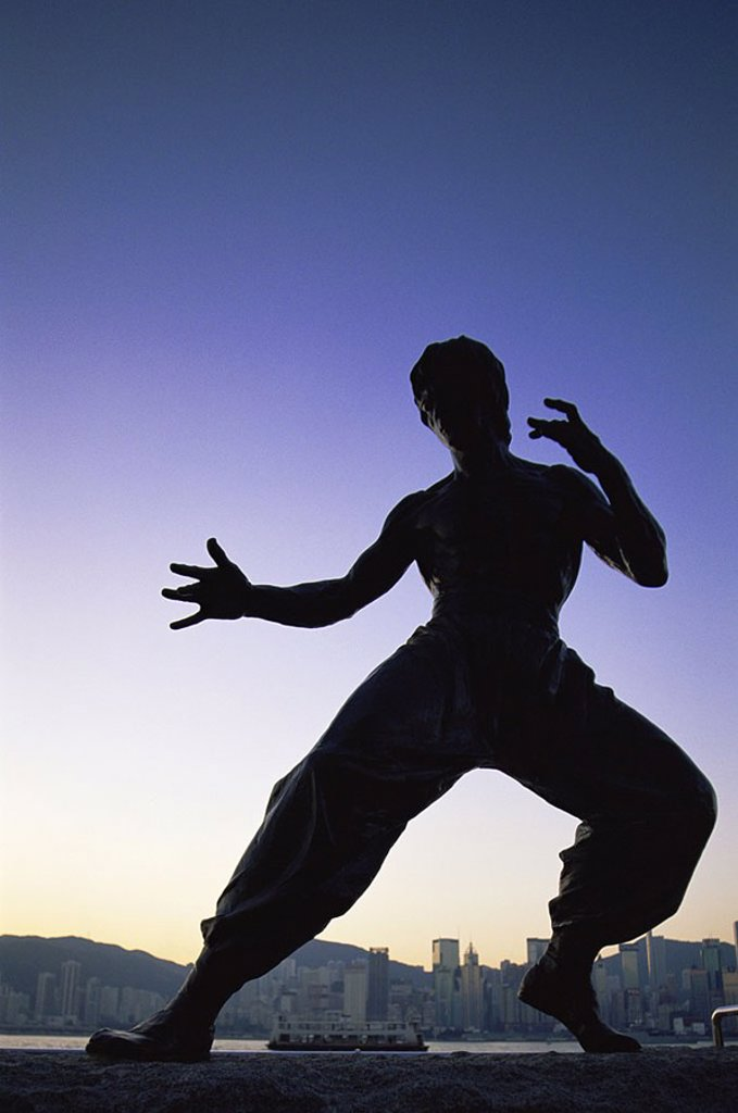 Stock Photo: 1609-22444 February 2007. China, Hong Kong, Kowloon, Tsim Sha Tsui, Avenue of the Stars, Bruce Lee Statue