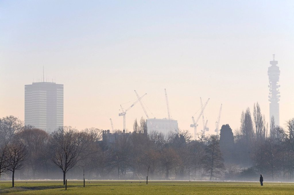 England, London, , Woman in Regents Park on a frosty morning with BT Tower in background : Stock Photo
