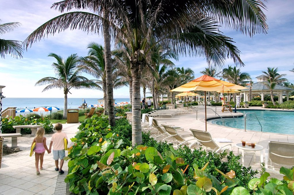 Stock Photo: 1609-26474 Children walk by one of the four pools at Breakers Hotel, Palm Beach, Florida, USA