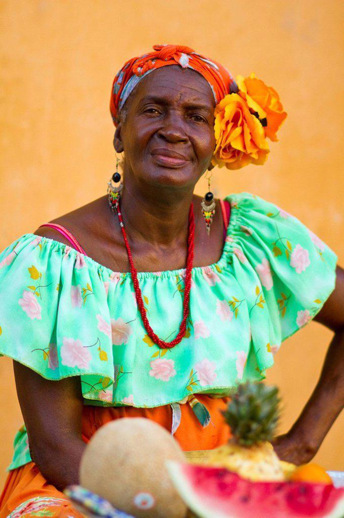 Colombia, Bolivar, Cartagena De Indias, Plaza de Santa Domingo,Woman selling fruit : Stock Photo