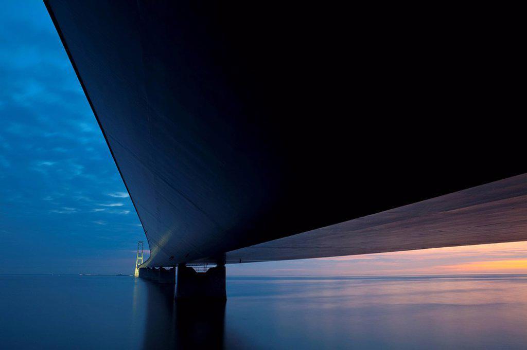 Dusk over the illuminated East Bridge as seen from Korsor, Denmark. : Stock Photo