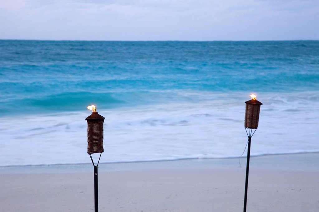 Torches on beach, Grace Bay, Providenciales, Turks and Caicos : Stock Photo