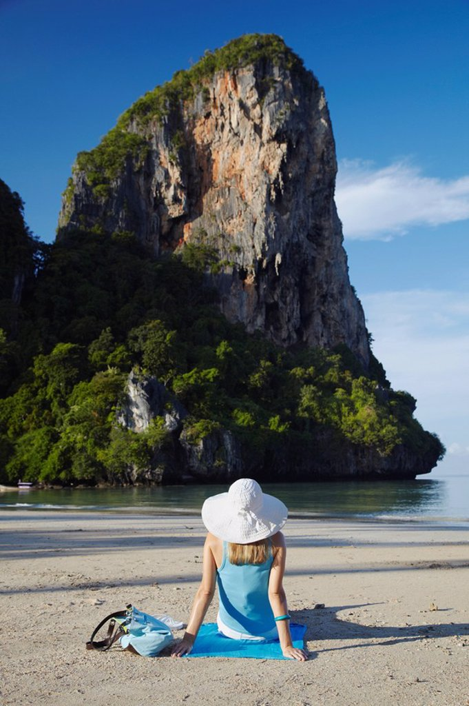 Stock Photo: 1609-40468 Woman relaxing on Hat Rai Leh West beach, Railay, Krabi Province, Thailand MR