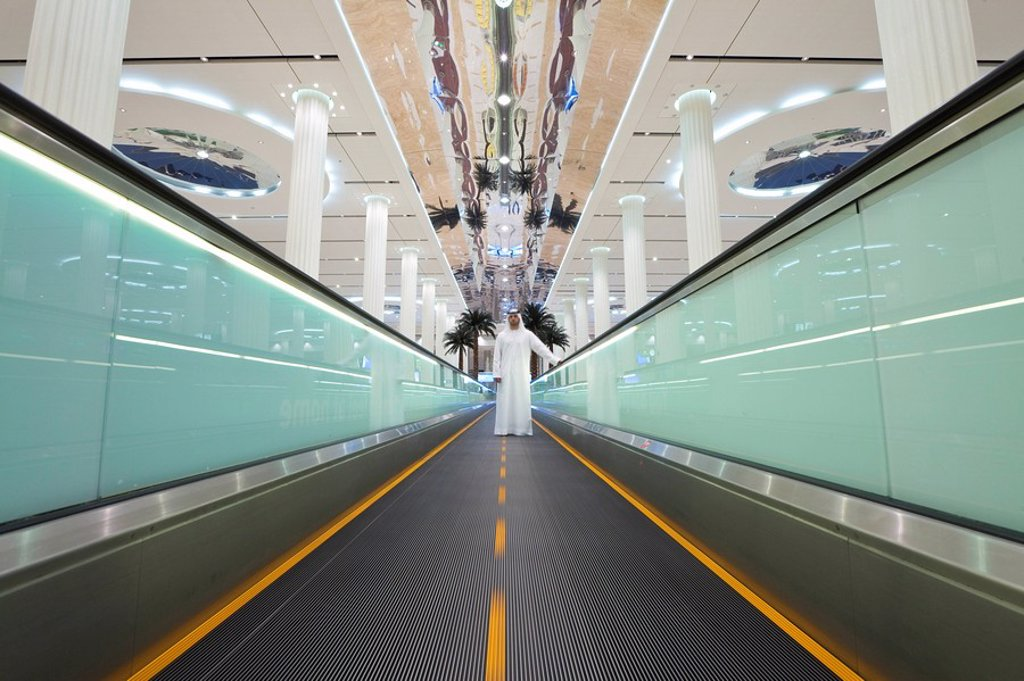 United Arab Emirates UAE, Dubai, Dubai International Airport, Terminal 3, Arrivals Hall, Moving walkway : Stock Photo