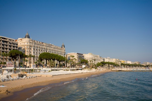 Beach and Boulevard de la Croisette with Carlton Hotel, Cannes, Cote D'Azur, France : Stock Photo