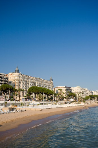 Stock Photo: 1609R-29453 Beach and Boulevard de la Croisette with Carlton Hotel, Cannes, Cote D'Azur, France
