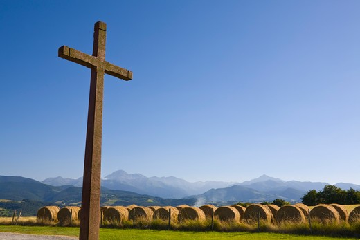Crucifix & Hay Bales, Chapel Cieutat, Hautes-Pyrenees, France : Stock Photo