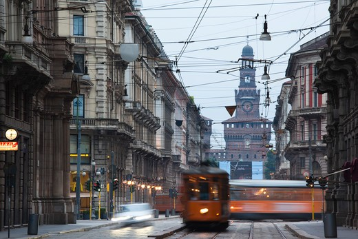 Italy, Lombardy, Milan, Milan trams on Via Orefici with Castello Sforzesco : Stock Photo