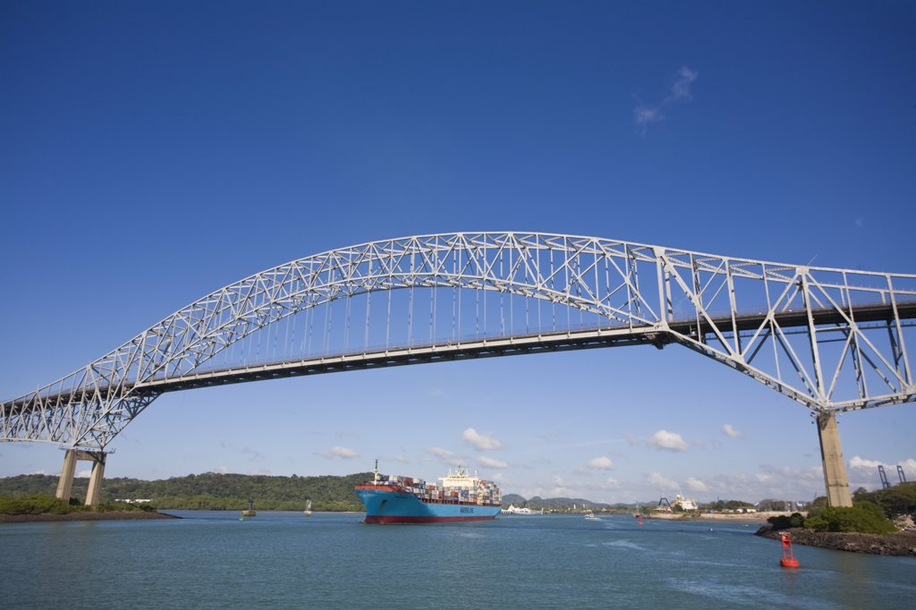 Panama, Panama city, Container ship sailing under the Bridge of the Americas : Stock Photo