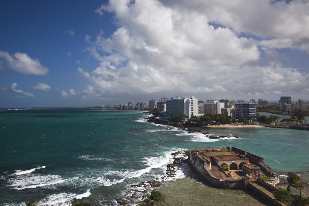 Stock Photo: 1609R-31007 Puerto Rico, San Juan, elevated view of Condado hotels and Fuerte San Geronimo fort, daytime
