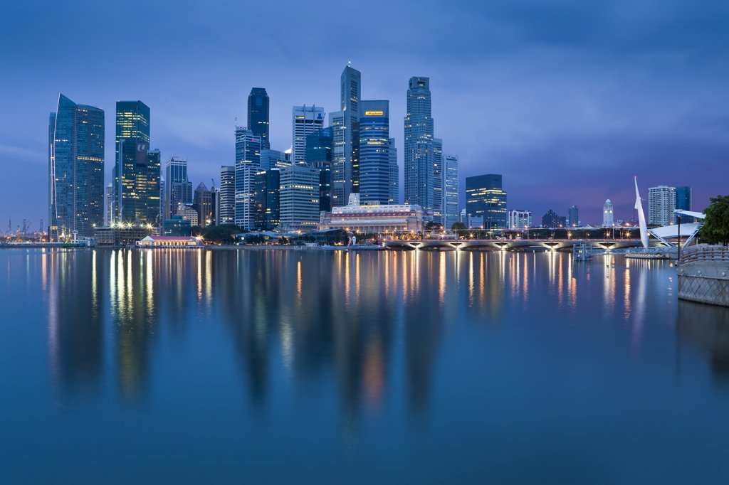 Asia, Singapore, Singapore Skyline and Financial district under gathering storm clouds : Stock Photo