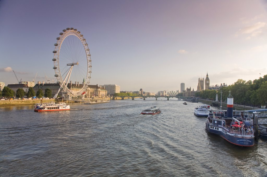 Stock Photo: 1609R-31865 England, London, People having drink on river boat/restaurant  &Houses of Parliment  & Millennium Wheel