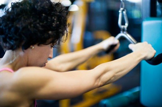 Stock Photo: 1610-213 Side profile of a young woman exercising in a gym