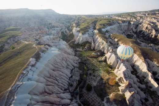 Stock Photo: 1610-218 Aerial view of a hot air balloon floating over mountains, Cappadocia, Turkey