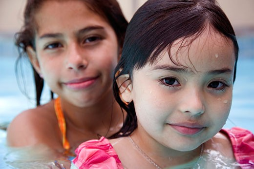 Stock Photo: 1610-275 Portrait of two girls in a swimming pool