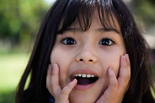 Stock Photo: 1610-278F Portrait of a girl looking surprised