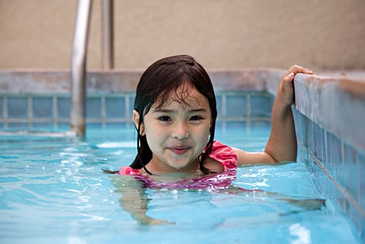 Portrait of a girl in a swimming pool : Stock Photo