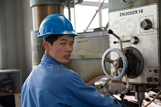 Portrait of a worker working in a steel mill : Stock Photo