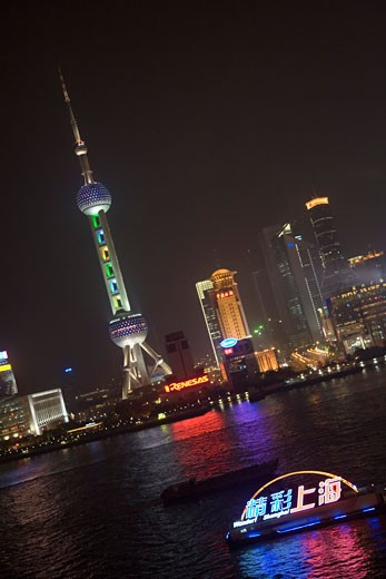 Stock Photo: 1610-380 Low angle view of buildings lit up at night, Oriental Pearl Tower, Pudong, Shanghai, China